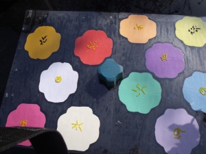 Paper flowers, with icing in stamen like patterns